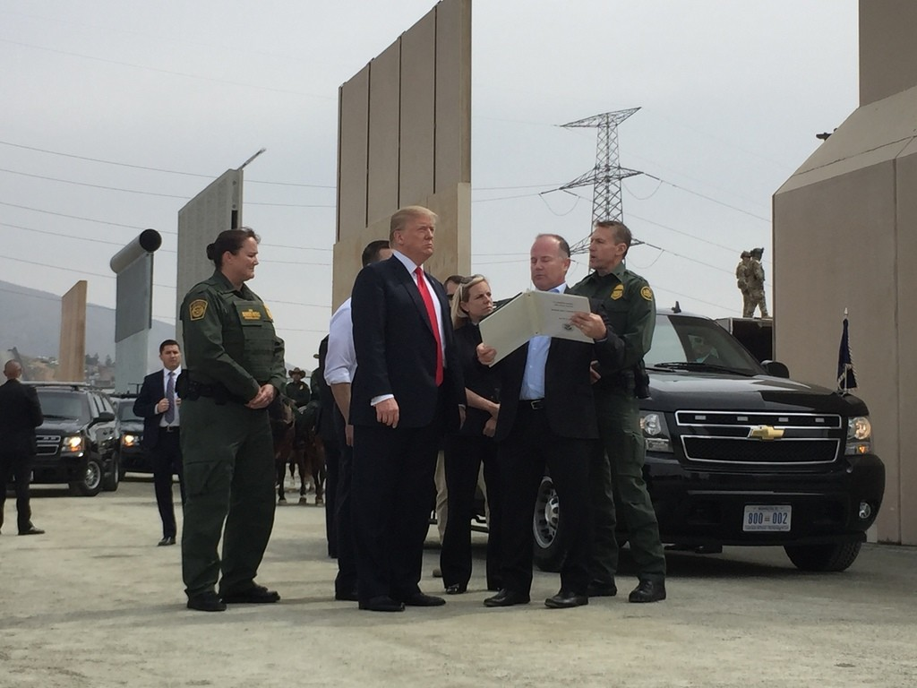 President Trump reviews border wall prototypes (Joel Pollak / Breitbart News)