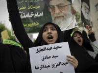 An Iranian hard line student chants as she holds the names of Bahraini Shiite Muslim protesters who were sentenced to death and life in prison by Bahraini military court outside the Bahrain embassy in Tehran on April 30, 2011, during a protest to commemorate the people who were killed in Bahrain uprising. AFP PHOTO/BEHROUZ MEHRI (Photo credit should read BEHROUZ MEHRI/AFP/Getty Images)