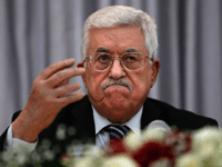 Palestinian President Mahmud Abbas gestures as he speaks during a Christmas lunch with members of the Christian Orthodox community on January 6, 2016 in the West Bank city of Bethlehem. Mahmud Abbas dismissed weeks of rumours the Palestinian Authority could collapse, saying he would 'never give up' on it. AFP …