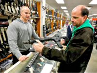 man in gun shop