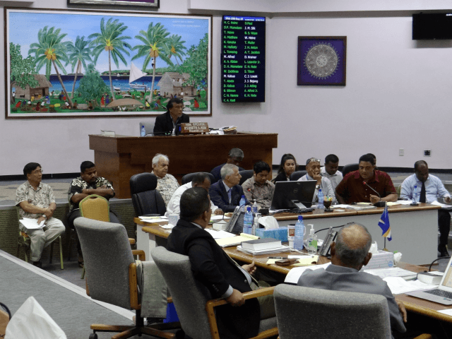 In this Feb. 23, 2018, photo, lawmakers listen to people discuss the pros and cons of creating a digital currency, in Majuro, Marshall Islands. The Marshall Islands is creating its own digital currency in order to raise some hard cash to pay bills and boost the economy. (AP Photo/Hilary Hosia)