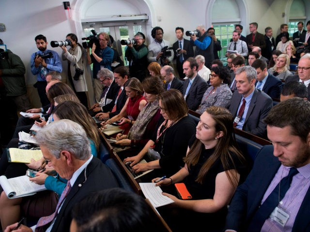 Members of the media attend the daily press briefing with White House Press Secretary Sarah Huckabee Sanders at the White House in Washington, DC, December 12, 2017. / AFP PHOTO / SAUL LOEB (Photo credit should read SAUL LOEB/AFP/Getty Images)