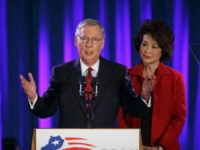 Senate Minority Leader Mitch McConnell of Ky., joined by his wife, former Labor Secretary Elaine Chao, celebrates with his supporters at an election night party in Louisville, Ky.,Tuesday, Nov. 4, 2014. McConnell won a sixth term in Washington, with his eyes on the larger prize of GOP control of the …