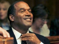 Miami, UNITED STATES: (FILES) Photo dated 09 October 2001 shows O.J. Simpson adjusting his tie before the jury selection of his trial at the Miami circuit court in Miami. Simpson describes in a Fox television interview 'how he would have carried out' the murder of his ex-wife and her friend, which he has denied committing for more than a decade, the network said 15 November 2006. The two-part interview with Simpson, who was acquitted of the 1994 murders of his ex-wife Nicole and her friend Ron Goldman, will broadcast 27 and 29 November in a special titled 'O.J. Simpson: If I Did It, Here's How It Happened.' 'O.J. Simpson, in his own words, tells for the first time how he would have committed the murders if he were the one responsible for the crimes,' Fox said. 'In the two-part event, Simpson describes how he would have carried out the murders he has vehemently denied committing for over a decade,' it said. AFP PHOTO/ POOL/Al DIAZ/FILES (Photo credit should read AL DIAZ/AFP/Getty Images)
