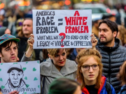 MIDTOWN MANHATTAN, NEW YORK, UNITED STATES - 2017/03/24: A crowd of about 300 people gathered in Union Square on the evening of March 24, 2017; for an emergency action to say Enough is Enough. The crowd rallied and proceed to march to Herald Square in Midtown Manhattan where Timothy Caughman …
