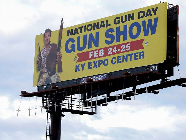 Seventeen crosses bearing the names and ages of those killed in last month's shooting at Marjory Stoneman Douglas High School in Parkland, Fla., were hung overnight from a Louisville billboard that advertises a local gun show. A spokeswoman for billboard owner Outfront Media said Sunday, March 11, that the crosses would be removed.(Scott Utterback/Courier Journal via AP)