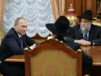 In this Wednesday, Dec. 9, 2015 photo, Russian President Vladimir Putin, left, meets with Chief Rabbi of Russia Berl Lazar, foreground, and head of the Federation of Jewish Communities Alexander Boroda, right, in Moscow's Kremlin, Russia. (Alexei Druzhinin/Sputnik, Kremlin Pool Photo via AP)
