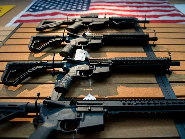 Assault rifles hang on the wall for sale at Blue Ridge Arsenal in Chantilly, Virginia, on October 6, 2017. / AFP PHOTO / JIM WATSON (Photo credit should read JIM WATSON/AFP/Getty Images)