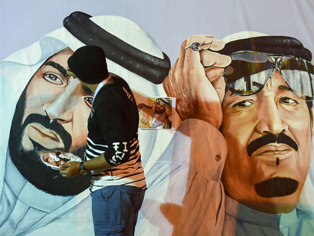 Saudi artists paint a mural portrait of King Salman bin Abdulaziz (R), and his son Crown Prince Mohammed bin Salman, during the 32nd Janadriyah Culture and Heritage Festival, held on the outskirts of the capital Riyadh on February 17, 2018. / AFP PHOTO / Fayez Nureldine (Photo credit should read …