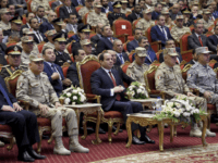 In this photo released by the Egyptian Presidency, Egyptian President Abdel-Fattah el-Sissi, center, attends a conference commemorating the country's martyrs, in Cairo, Egypt, Thursday, March 15, 2018. Up for re-election in less than two weeks, Egypt's president on Thursday took center stage at a televised ceremony declaring his readiness to personally join the battle against militants and decorating soldiers and families of fallen ones. (Sherif Abdel Meniom/Egyptian Presidency via AP)