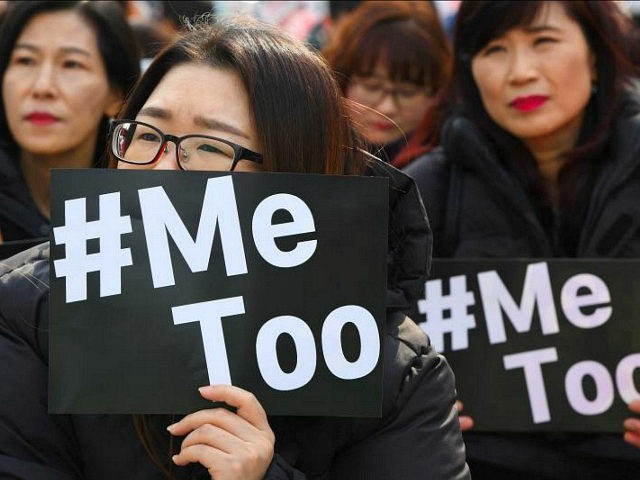 TOPSHOT - South Korean demonstrators hold banners during a rally to mark International Women's Day as part of the country's #MeToo movement in Seoul on March 8, 2018. The #MeToo movement has gradually gained ground in South Korea, which remains socially conservative and patriarchal in many respects despite its economic …