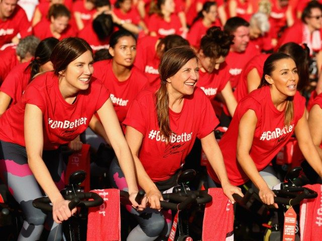 women participating in a spin class