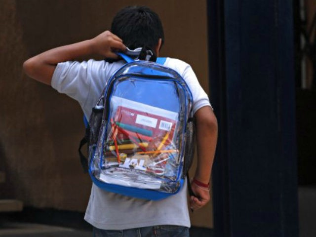 A secondary school student walks carrying his new transparent backpack in Guadalajara, Mexico on October 25, 2012. The transparent backpacks are part of the program 'Escuela Segura' (Safe School ) to avoid violence in schools and in the coming days the State Government will deliver 10,000 more of these hoping …
