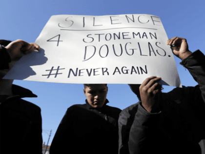 Students participate in a walkout to protest gun violence at Lincoln Park High School in response to last month's massacre of 17 people at Florida's Marjory Stoneman Douglas High School, Wednesday, March 14, 2018, in Chicago. (AP Photo/Nam Y. Huh)