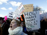 Students hold up their signs during a rally asking for gun control outside of the U.S. Capitol building, in Wednesday, March 14, 2018, in Washington. One month after a mass shooting in Florida, students and advocates across the country participate in walkouts and protests to call on Congress for action. …