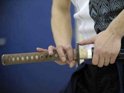 LIFESTYLE-JAPAN-HEALTH-FITNESS Takafuji Ukon (C), a 31-year-old choreographer, dancer and fitness expert shows his skills of sword dancing after his 'Katana Exercise' fitness lesson at a studio in Tokyo on May 1, 2010. Japan's ancient samurai swords were once used to slice apart enemies, but in a new fitness craze they …