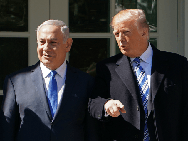 US President Donald Trump poses for a photo with Israel's Prime Minister Benjamin Netanyahu and in the Rose Garden of the White House on March 5, 2018 in Washington, DC. President Donald Trump said he 'may' attend the opening of a controversial new US embassy in Jerusalem, a fraught prospect …