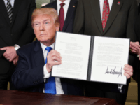 US President Donald Trump signs trade sanctions against China on March 22, 2018, in the Diplomatic Reception Room of the White House in Washington, DC, on March 22, 2018. Trump will impose tariffs on about $50 billion in Chinese goods imports to retaliate against the alleged theft of American intellectual …