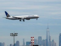 A United Continental Holdings Inc. airplane prepares for landing as the New York City skyline stands in the background at Newark Liberty International Airport (EWR) in Newark, New Jersey, U.S., on Wednesday, April 12, 2017. United Airlines is under fire for forcibly removing a passenger from a plane in Chicago …