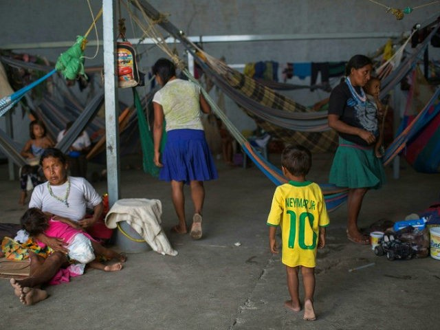 Venezuelan refugees rest inside a temporary shelter in the city of Pacaraima in Brazil