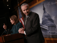 WASHINGTON, DC - MARCH 22: U.S. Senate Minority Leader Chuck Schumer (D-NY) and House Minority Leader Nancy Pelosi (D-CA) speak at a news conference at the U.S. Capitol on March 22, 2018 in Washington, DC. Pelosi and Schumer answered questions on the omnibus spending bill that was passed by the …