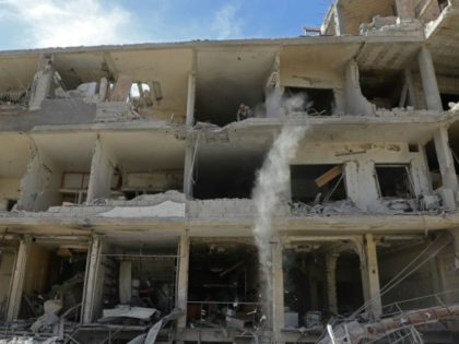 A partially destroyed building in Kfar Batna in the Syrian rebel enclave of Eastern Ghouta on March 1, 2018 following reported air strikes by Syrian government forces