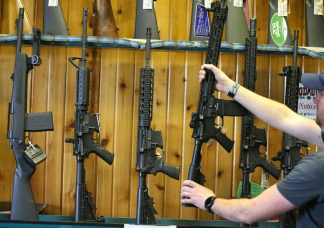 Semi-automatic AR-15s displayed for sale at Good Guys Guns & Range in Orem, Utah