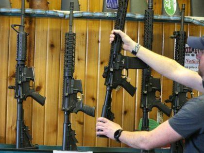 Semi-automatic AR-15s displayed for sale at Good Guys Guns & Range in Orem, Utah