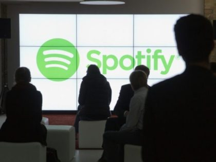 In an unusual move, Spotify said it would list existing shares directly on the New York Stock Exchange rather than issue new shares, allowing its founders and investors to maintain control and avoiding the cost of hiring Wall Street underwriters