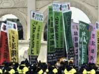 "Pro-Taiwan indepedence activists hold banners on the 70th anniversary of the ""228 Incident"", a violent mainland crackdown"