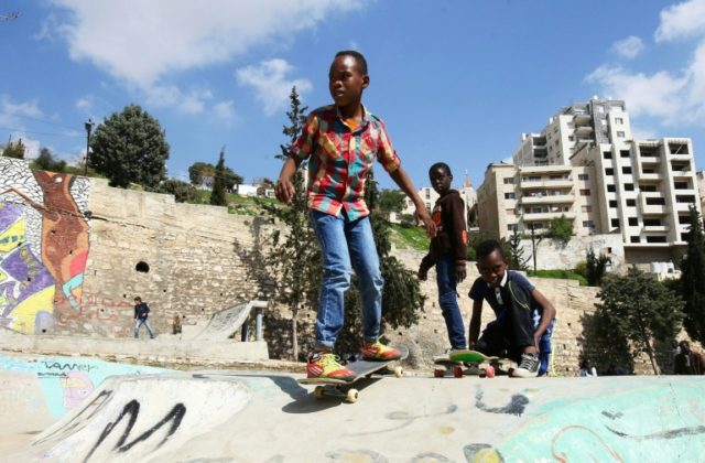Refugee children in the Jordanian capital Amman enjoy some fun at a skate park in city built by volunteers with money raised by a fundraising campaign by a German NGO while a local association offers skateboarding classes free of charge