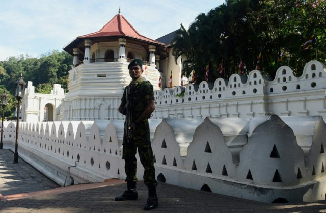 Sri Lankan police have imposed a curfew in the riot-hit central district of Kandy, home to famous tea plantations and Buddhist relics