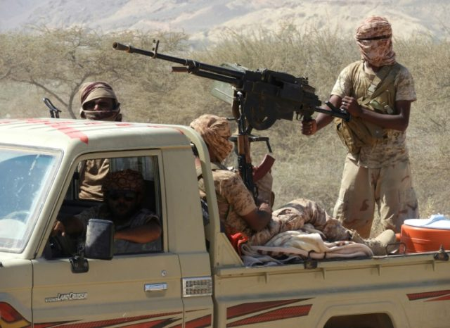 Yemeni fighters loyal to the government backed by the Saudi-led coalition ride in the back of a pickup truck during their the offensive in the Mesini Valley in the vast province of Hadramawt in February 2018
