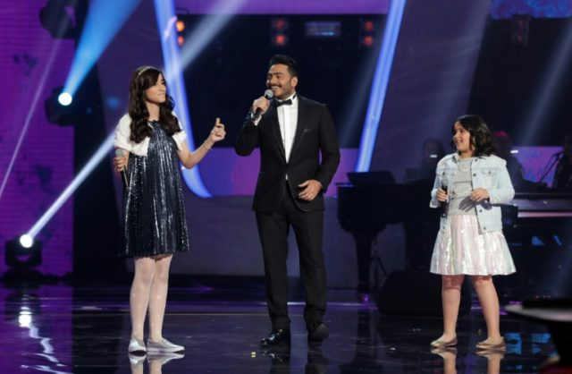 "Egyptian singer and judge Tamer Hosny (C) sings during ""The Voice Kids: Ahla Sawt"" show on February 3, 2018, at MBC studios north of the Lebanese capital Beirut"