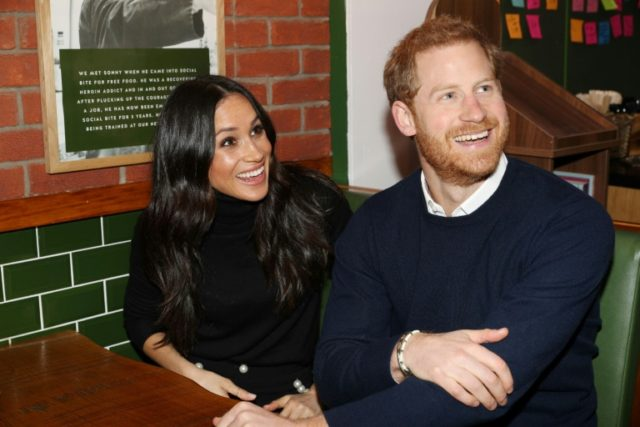 Britain's Prince Harry (R) and his fiancée US actress Meghan Markle will marry at St George's Chapel, Windsor Castle on May 19, 2018