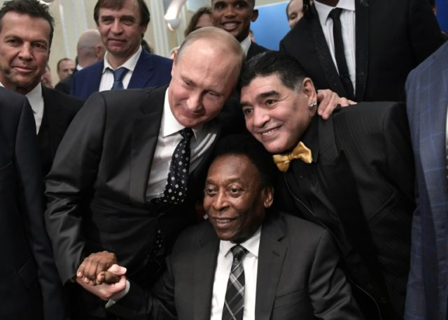 Russian President Vladimir Putin, Brazilian football legend Pele and Argentina's former midfielder Diego Maradona pose for pictures ahead of the Final Draw for the 2018 FIFA World Cup football tournament at the State Kremlin Palace in Moscow on December 01, 2017.