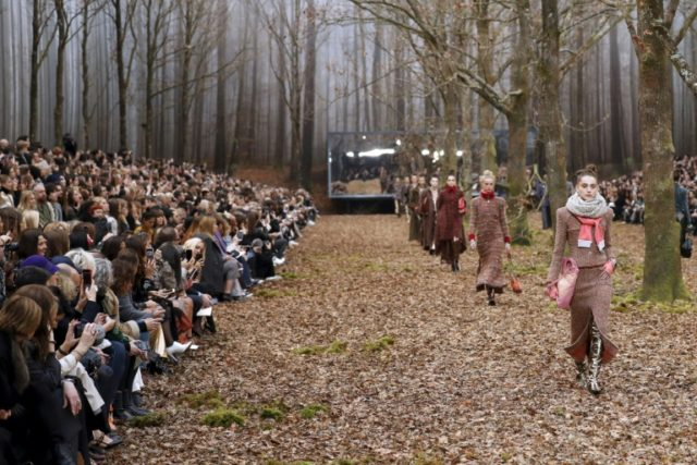 Karl Lagerfeld turned down the bling meter at Chanel with a Paris fashion week show that reflected the restrained glamour of the spectacular mid-winter forest in which it was set