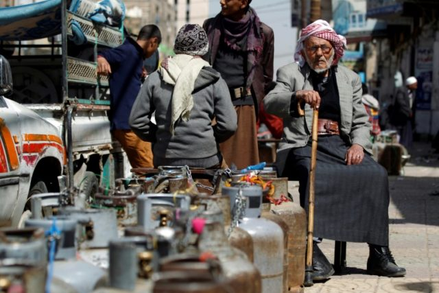 Yemeni men line the streets of the rebel-held capital Sanaa waiting alongside empty propane gas canisters they are desperate to replace so they have fuel to cook
