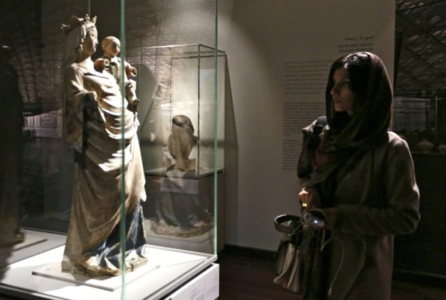 Iranians visit an exhibition of 50 artworks from French museum the Louvre, on March 5, 2018 at the National Museum in central Tehran, the first major show by a Western museum in the Iran's history