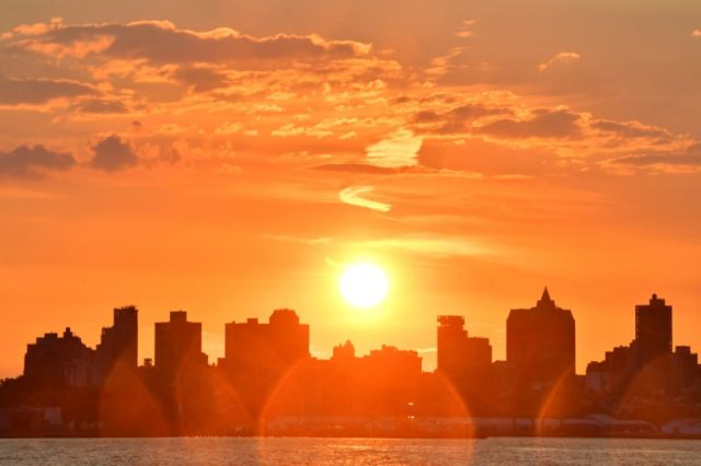 The sun rises over Brooklyn, on July 4, 2017 in New York City