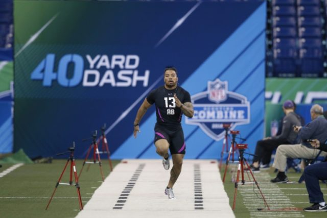 LSU running back Derrius Guice runs the 40-yard dash during the 2018 NFL Combine at Lucas Oil Stadium on March 2, 2018 in Indianapolis, Indiana