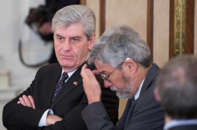 Mississippi Governor Phil Bryant (L) is expected to sign off on a new law imposing the toughest abortions in the country, despite protestations from rights groups