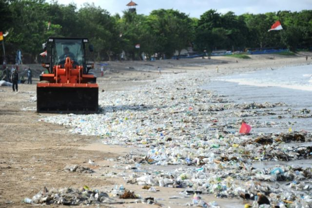 """Bali last year declared a """"garbage emergency"""" across a six-kilometre stretch of coast that included popular beaches Jimbaran, Seminyak and Kuta, where authorities used heavy equipment to clear plastic trash from the beach"""