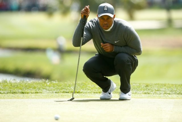 Tiger Woods looks over a putt on the second green during the first round of the Valspar Championship at Innisbrook Resort Copperhead Course on March 8, 2018 in Palm Harbor, Florida