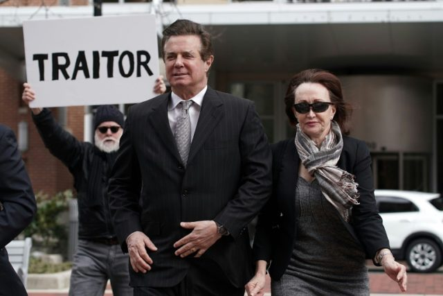 Former Trump campaign manager Paul Manafort (C) arrives with his wife Kathleen Manafort (R) at the federal courthouse in Alexandtria Virginia Thursday, where he pleaded not guilty to bank and tax fraud charges