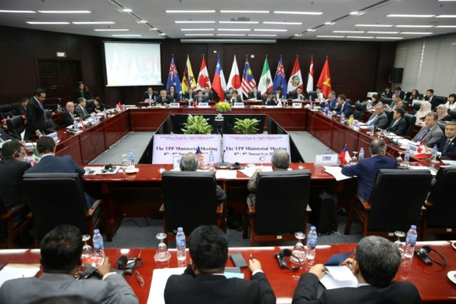 Trade ministers and delegates from the 11 remaining members of the Trans-Pacific Partnership (TPP) meet in Vietnam last November, in the leadup to a slimmed-down version of their trade pact's taking effect without the United States