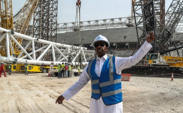 Qatar's Thani al-Zarraa, project manager of Al-Wakrah Stadium, a World Cup venue designed by celebrated Iraqi-British architect Zaha Hadid, directs workers at the site on February 6, 2018