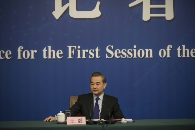 Chinese Foreign Minister Wang Yi tried to strike a balance between reassurance and assertiveness
