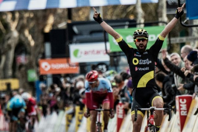 Winning style: Jerome Cousin celebrates winning the fifth stage of the Paris-Nice