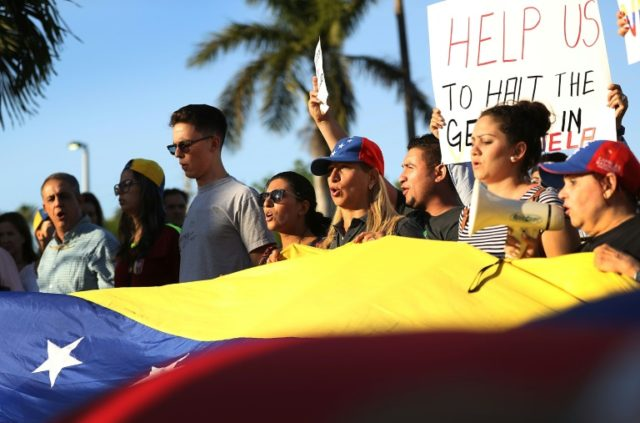 Venezuelans in Miami protest against Caracas in May 2017 during a rally hosted by Florida Governor Rick Scott to express support for the release of Venezuelan opposition leader Leopoldo Lopez